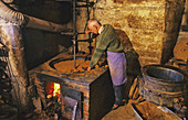Making nut oil in a traditional oil mill, Martel, Lot, France