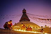 Buddhist monks prepare a ceremony for a deceased lama, stupa of Baudanath, Kathamandu, Nepal