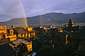 Rainbow over the former royal city of Bhaktapur in front of Everest range, valley of Kathmandu, Nepal