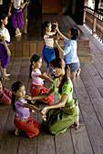 Girls and their teacher training in a Classic Khmer dance school (Apsara dance), Phnom Penh, Cambodia