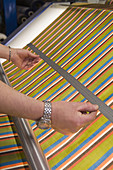 Industry, Textile, measuring a piece of tissu, France