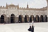 Two school  Girls walking inside Al-azhar Mosque in Cairo, Egypt