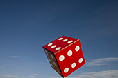 Blue, Blue sky, Chance, Close up, Close-up, Closeup, Color, Colour, Concept, Concepts, Daytime, Dice, Die, exterior, Flight, Flights, Fly, Flying, Gamble, Gambling, Game, Games, Gaming, Luck, Object, Objects, One, One item, outdoor, outdoors, outside, Pla