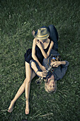 Adult, Adults, Barefeet, Barefoot, Calm, Calmness, Caucasian, Caucasians, Color, Colour, Contemporary, Country, Countryside, couple, couples, Daytime, exterior, female, Full body, Full length, Full-body, Full-length, Guitar, Guitars, Hat, Hats, Headgear,