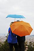 Couple kissing under the rain. Parc Güell. Barcelona. Catalonia. Spain