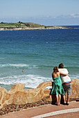 Young couple looking at the sea from a viewpoint  Piquío gardens  Santander  Cantabria province  Spain