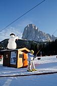 Child on a T-bar ski lift, Skiing, Winter, Sella, Seiseralm, Dolomites, South Tyrol, Italy