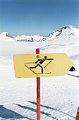 Cross country skiing trail with sign, Winter, Plaine Morte Glacier, Crans Montana, Switzerland