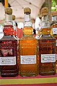Bottles of vinegar on the market, Orange vinegar, Raspberry vinegar, Collioure, Languedoc-Roussillon, South France, France