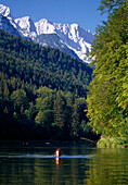A woman swimming in the Risser lake, Bavaria, Germany, Europe