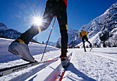 Two cross-country skiers under blue sky, Tyrol, Austria, Europe