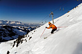 Skier at the descent on a mountain side, Kitzbuehel Alps, Tyrol, Austria, Europe