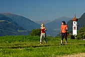 Young couple nordic walking in an idyllic landscape, Tyrol, Austria, Europe
