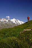 Woman at hike in the mountains under blue sky, Hohe Tauern, Austria, Europe