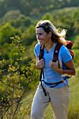 Woman with rucksack hiking at franconian Switzerland, Bavaria, Germany, Europe