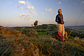 Woman looking at the view in the evening light, Walberla, Bavaria, Germany, Europe