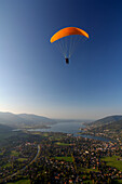 Person paragliding near Lake Tegernsee, near Rottach-Egern, Tegernsee, Upper Bavaria, Bavaria, Germany