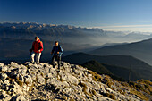 Couple on a hiking tour at heimgarten, Upper Bavaria, Bavaria, Germany