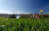 Family on a hiking tour at lake Riegsee, near Murnau, Upper Bavaria, Bavaria, Deutschland