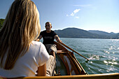 Couple in a rowing boat on Lake Tegernsee, Upper Bavaria, Bavaria, Germany
