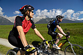Couple on a mountain bike tour near Obermieming, near Telfs, Mieminger Plateau, Tyrol, Austria
