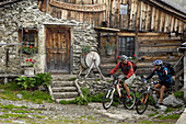 Two people on a mountain bike tour to Seapen Alm, near Steinach am Brenner, Wipptal, Tyrol, Austria