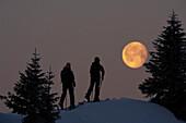 People on a ski tour at Hochgrat at full moon, Allgäu Alps, Bavaria, Germany, Europe