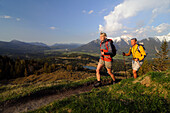 Couple hiking, Kranzberg, View towards the Karwendel, Mittenwald, Upper Bavaria, Bavaria, Germany, Europe