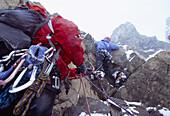 Mountaineers climbing, Bernina Range, Engadin, Grisons, Switzerland
