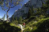 Man mountain hiking near Wendelstein, Mangfall range, Bavaria, Germany