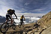 Couple mountain biking, Lenzerheide, Canton of Grisons, Switzerland