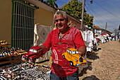 Hawker offering toy cars, Trinidad, Sancti Spiritus, Cuba, West Indies