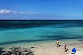 View over sandy beach to horizon over Atlantic Ocean, Guardalavaca, Holguin, Cuba, West Indies
