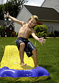 Brady, 7, cools off at home in North Olmsted, Ohio, USA.