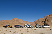 4x4, Adventure, Adventures, Caravan, Caravans, Color, Colour, Contemporary, Daytime, Desert, Deserts, exterior, Four-wheel drive, holiday, holidays, human, Mountain, Mountains, outdoor, outdoors, outside, people, person, persons, Pick-up truck, Pickup tru