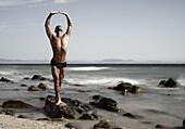 Beach, Body, Fit, Form, Human, Man, Mind, Natural, Nature, Pose, Posing, Rock, Sea, Seascape, Shape, Sport, Yoga, A75-807075, agefotostock