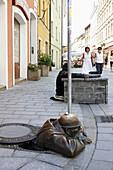 Rubberneck statue sticking out of a manhole, Bratislava, Slovakia