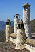 Spain. Andalusia. Granada. Typicals chimneys,  on the flats roofs,  at Bubion,  in the Alpujarras mountains.