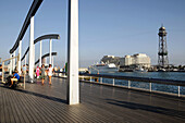 Rambla del Mar footbridge to Maremagnum area and the World Trade Center building at the back, Barcelona harbour, Catalonia, Spain