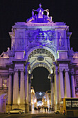 Christmas lights illuminate the gateway to Praca de Dom Pedro IV, popularly known as the Rossio and the citys main square, Lisbon, Portugal
