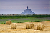 St Michaels Mount and farm land with wheat bales, Manche Department, Basse-Normandie region, Normandy, France, Europe