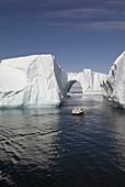 Icebergs in Disko Bay, Natural arch, Motorboat, UNESCO World Heritage Site, Ilulissat, Jakobshavn, Greenland, Denmark