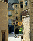 Tall houses surrounding small square, Sarlat, The Dordogne, France