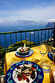 Fish dish at a terrace with sea view, Capri, Italy, Europe