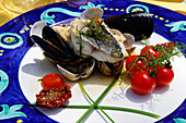 Fish dish on a plate, Capri, Italy, Europe