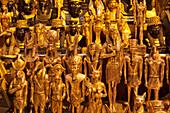 Shining statues of egyptian pharaos and gods, Bazaar Khan el-Khalili, Cairo, Egypt, Africa