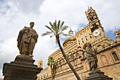 A palm tree and statues in front of the cathedral, Palermo, Sicily, Italy, Europe