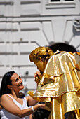 Living statue kissing hand of a woman, riding school, Hofburg Imperial Palace, Vienna, Austria