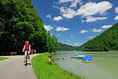 Female cyclist riding along Danube river, Danube Cycle Route Passau to Vienna, Schloegen, Upper Austria, Austria