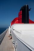 Sun deck with funnel, Cruise liner, Queen Mary 2, Atlantic ocean